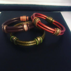 three striking round leather bracelets.j