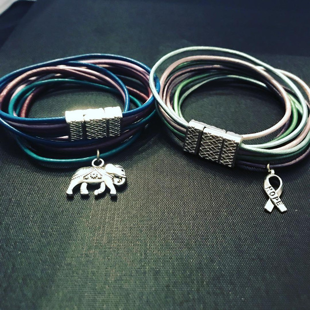 leather strings and charms.jpg