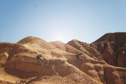 aerial shot of cyclist riding on a dirt mountain