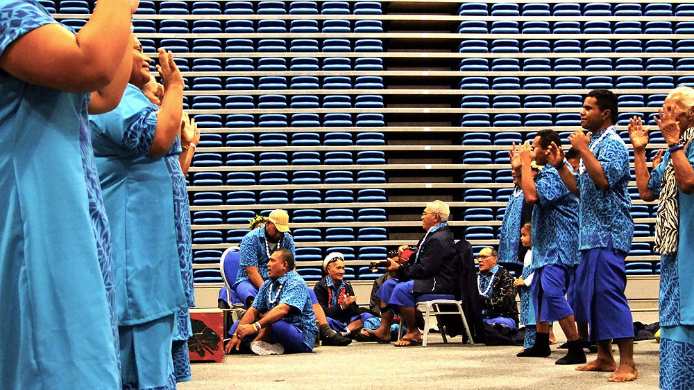 Hon Kelihiano Kalolo playing the guitar as the group from Atafu performs on the opening day. Photo F. Tauafiafi
