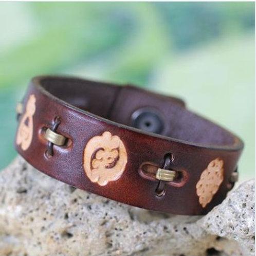 Men's African Leather Adjustable Wristband Bracelet, 'Brown Adinkra Celebration'