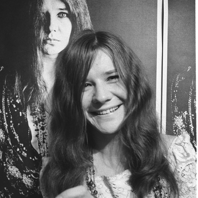 Janis Joplin with Bob Seidemann poster at her home in the Haight-Ashbury, November 1967