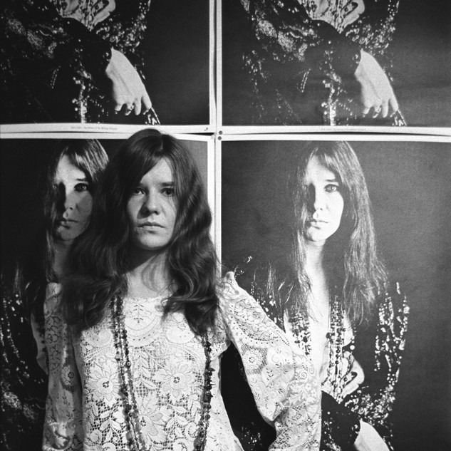 Janis Joplin with Bob Seidemann poster at her home in the Haight-Ashbury, November 1967