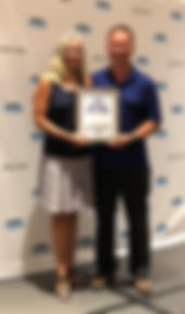 M and EM with award.jpg