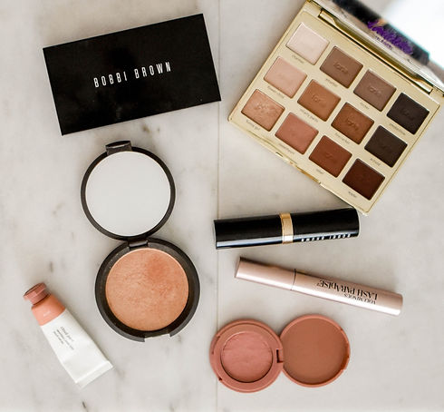 photo of assorted makeup products on gray surface_edited.jpg