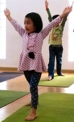 adorable little girl with arms raised.jpg