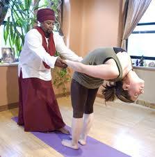 Guru Rubee doing asana.jpg