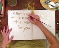 Maha Rose writing in notebook.jpg