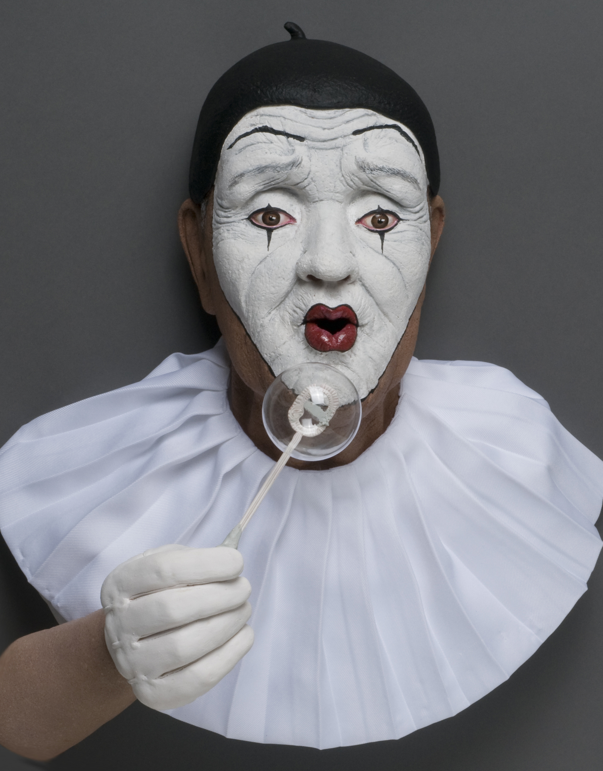 Old And Sad Mime Blowing Bubbles