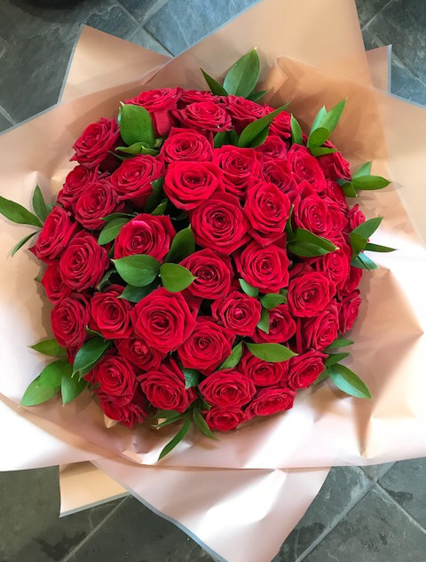 50 Red Roses. We also do 24 Rose and 12 Rose Bouquets in Reds, Whites, Pinks and  Yellows