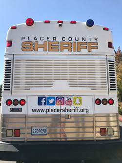 Sheriff Council Bus at Day with a Deputy