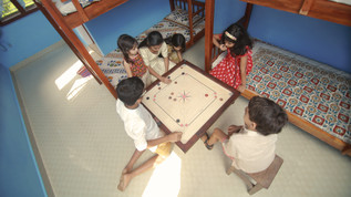 Playing carom in one of our rooms