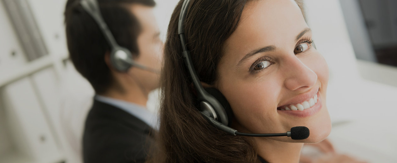 Smiling customer service staff in call c