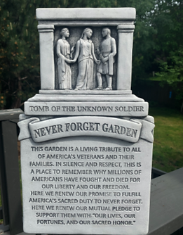 never forget garden plaque.png
