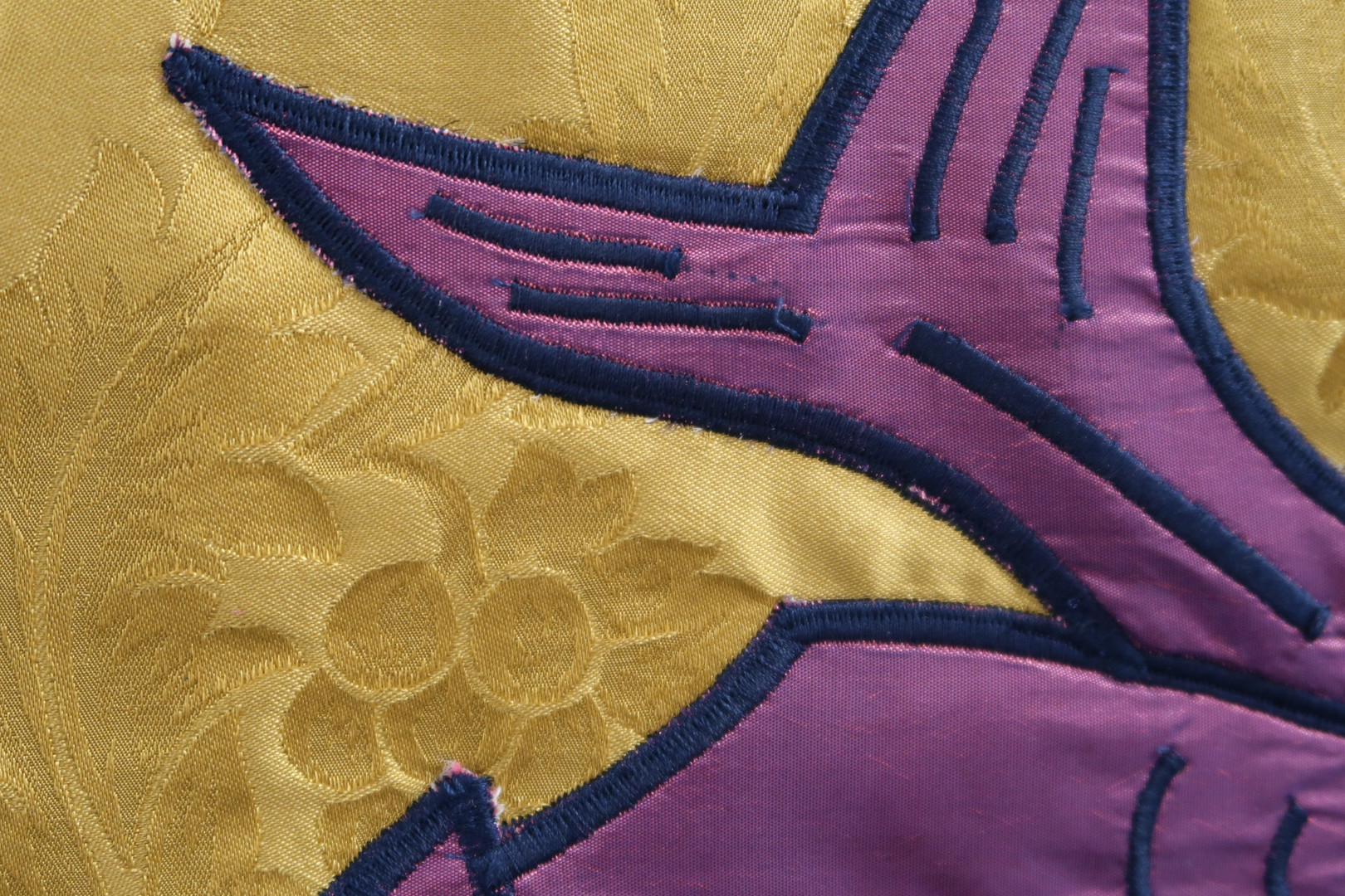 The motif was then transferred to the final fabric, backed with interfacing, and satin stitched around all raw edges, and design lines.