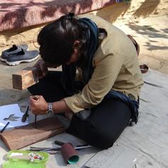 A KumaonBuild team member carving