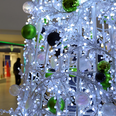 Chic contemporary Christmas tree with baubles and LED lights