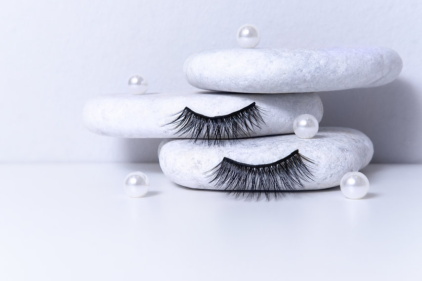 Magnetic fake artificial eyelashes and pearl on white stones. Home eyelash extension, cosm...nce.jpg