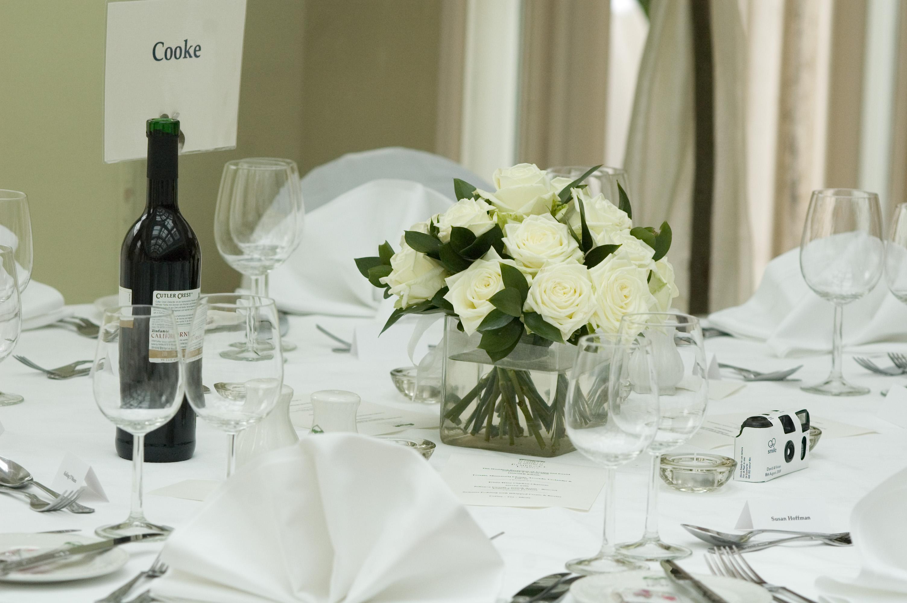 Tank Vase of White Roses