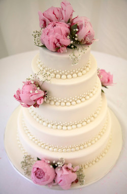 Cake decorated with peonies