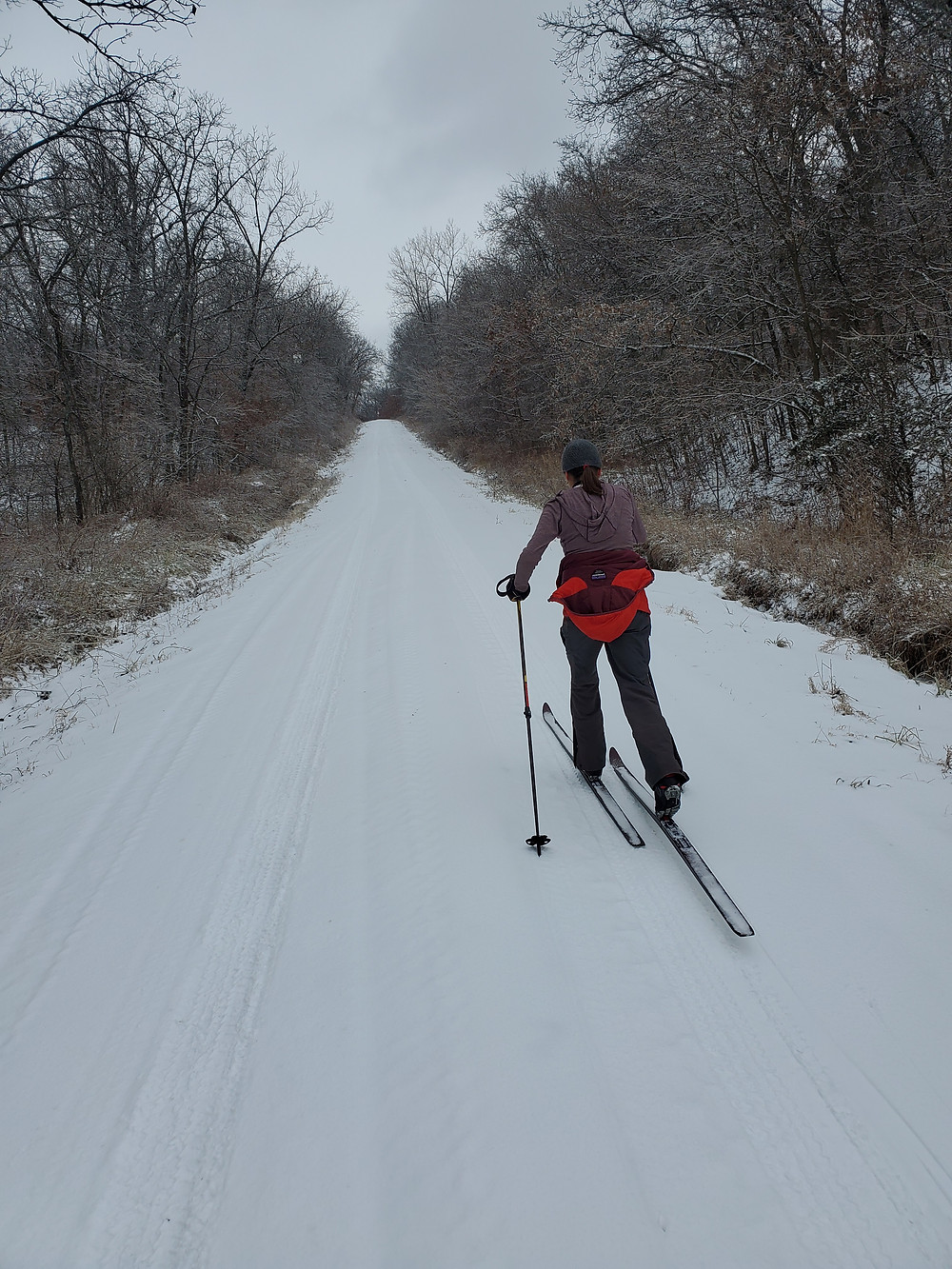 Woman skis on road