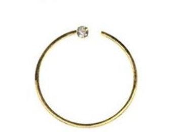 14 karat guld ring med diamand, 0,6 mm. trådtykkelse, 10 mm. dia. kugle 1,4 mm.