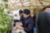 Drie sushichefs van Esaki Sushi aan het werk op het Sushifestival in de Japanse Tuin