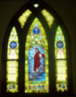 Rebuilt religious stained glass window