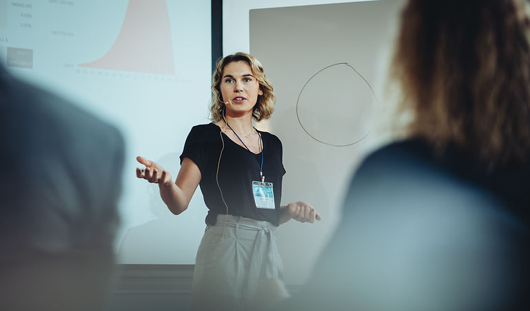 Woman presenting her idea to colleagues
