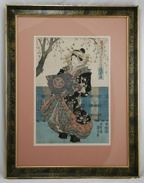 Utagawa Kunisada (1786-1865) 'Courtesan carrying a robe with Dragon Cartouche'