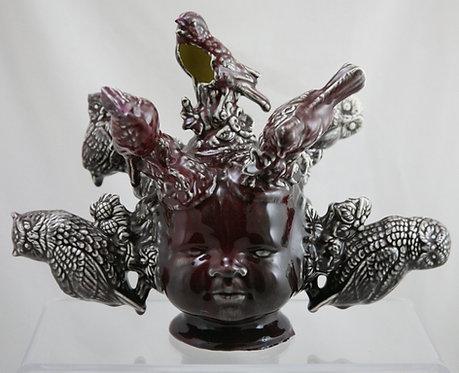 Grace S. Putnam Baby 'Bye-Lo' Head Vase with Birds in Maroon Gloss Glazes