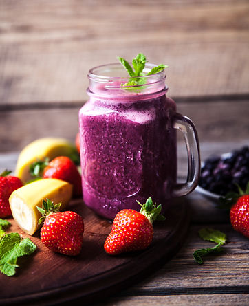 Blueberry smoothies on a wooden backgrou