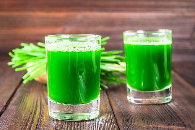 Wheatgrass shot. Juice from wheat grass.