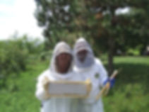 Shari with a frame of honey.JPG