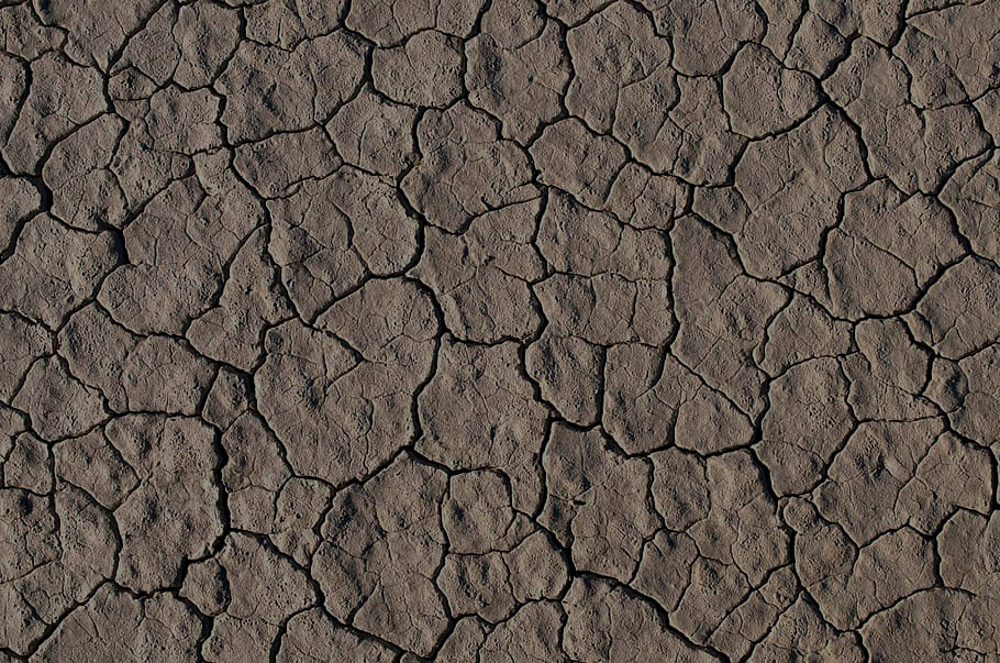 rock-ground-cracks-desert Med Dark.jpg