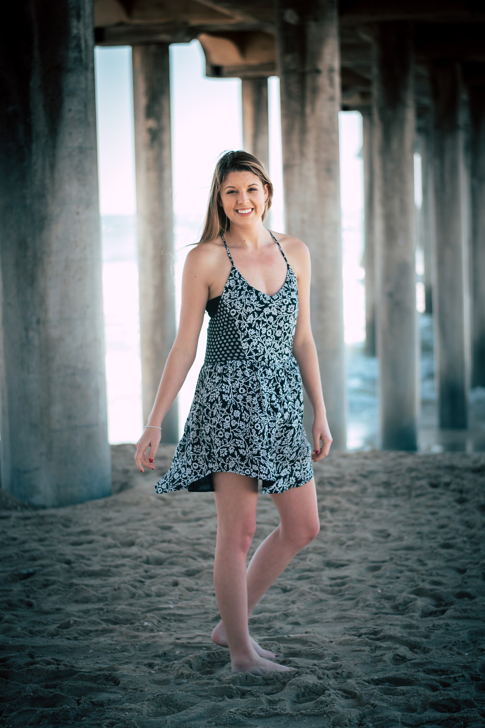 Holly Canon Travel and Lifestyle Blog The Bearded Bousman Photo Co Disneyland and Huntington Beach Inspyre Boutique dress under Pier 13