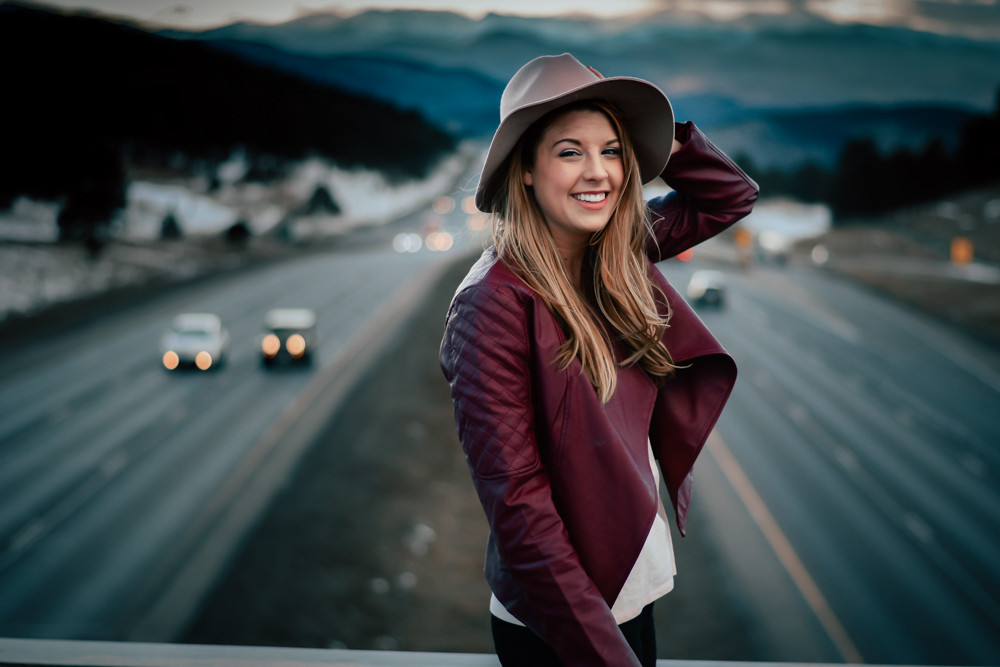 Holly Canon Travel and Lifestyle Blog Inspyre Boutique Leather Jacket Denver Colorado Overpass Mountains