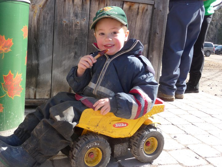 Young Logan Eating Taffy in dump truck