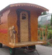 avancée de roulotte avec rambarde en frêne