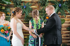 Handfast ceremony at tropical wedding