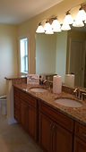 beautiful remodeled bathroom with granie countertops, soft close cabinets, large mirror, and semi private commode