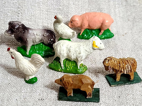 A Group of Smaller Chalk and Wooden Farm Animals