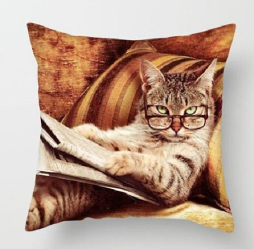 Tabby Cat Kitten with Glasses Reading a Newspaper