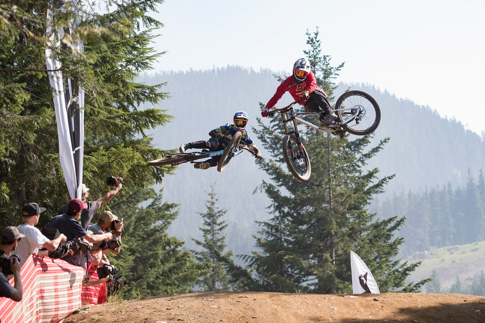 two-riders-whip-their-bikes-during-whistler-blackcombs-2018-crankworx-whip-off