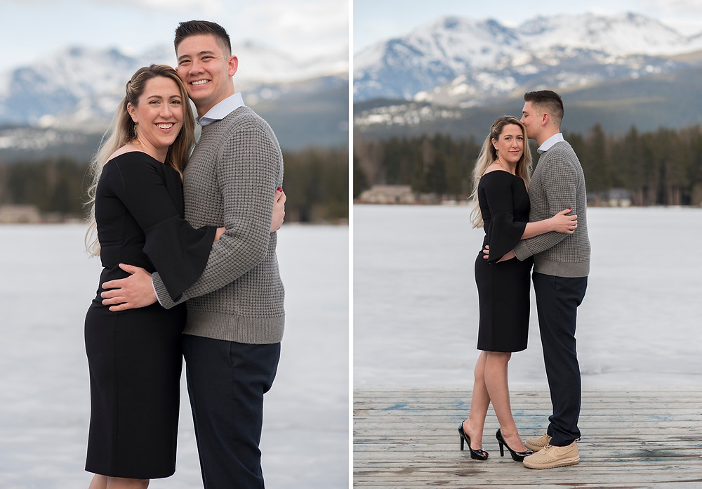 Couple smile for portraits in Whistler next to frozen lake