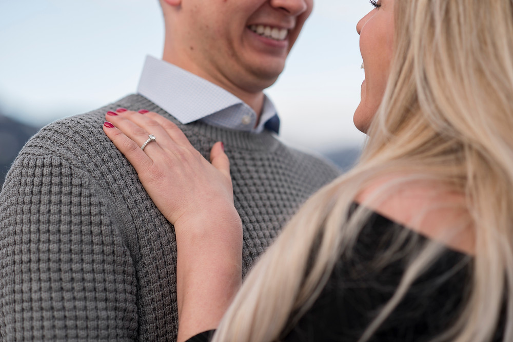 Man woman laugh showing off engagement ring