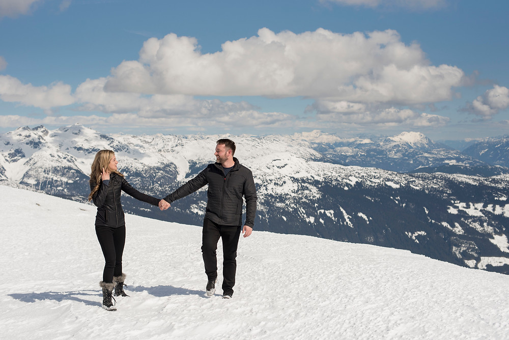 couple-walk-atop-rainbow-mountain-after-engagement