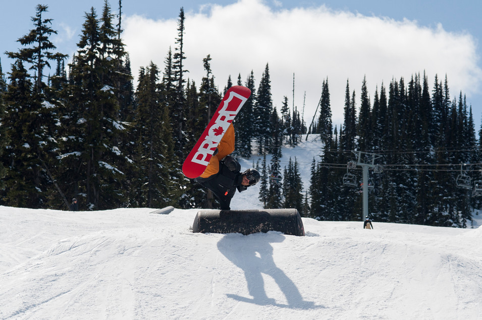 snowboarder-does-miller-flip-on-prior-snowboard-over-feature-whistler-blackcomb-terrain-park