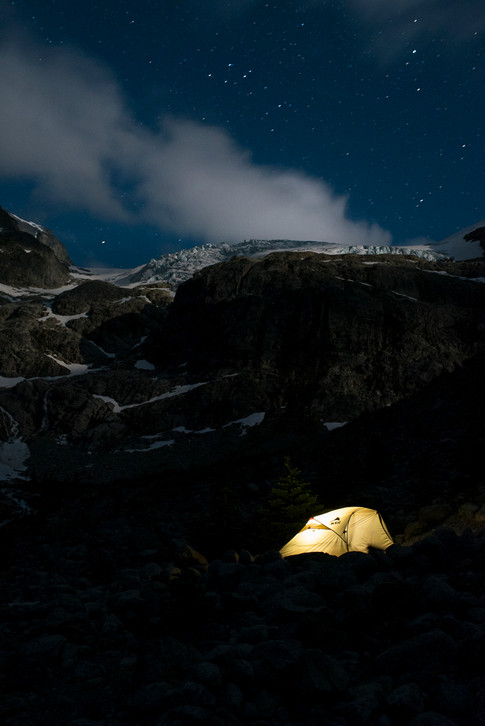mountain-safety-research-tent-illuminated-by-head-lamp-with-matier-glacier-joffre-lake-behind