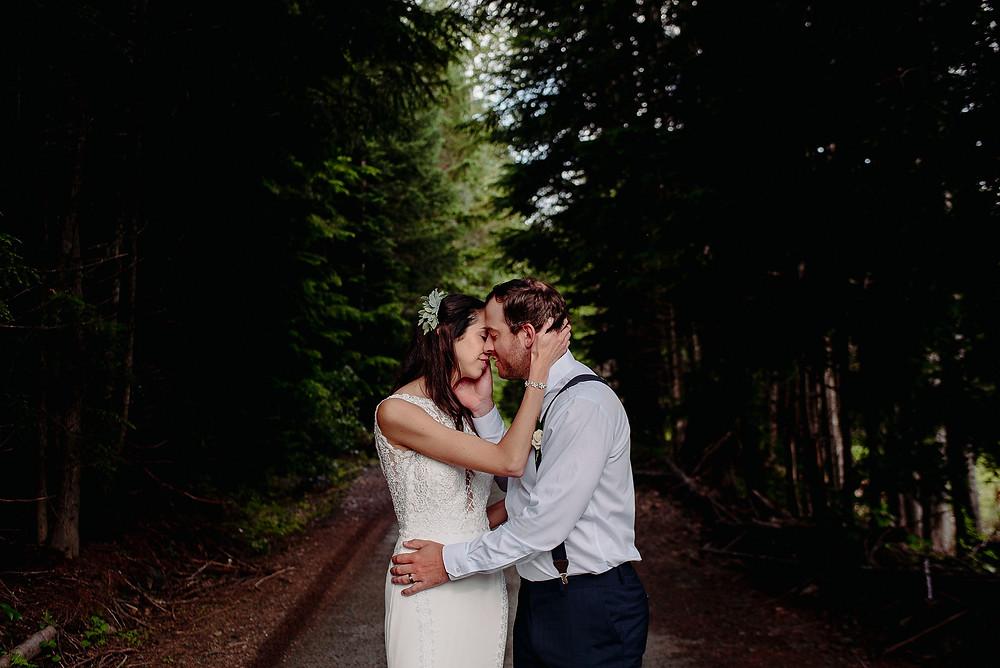 bride groom kiss whistler wedding forest